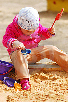 The Little Girl In A Sandbox Stock Images - Image: 15891434