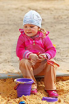 The Little Girl In A Sandbox Royalty Free Stock Photography - Image: 15891467