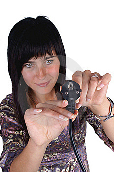 Woman Plugging Electric Cord Stock Photography - Image: 15891922