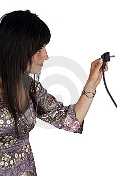 Woman Plugging Electric Cord. Side View. Stock Image - Image: 15891941