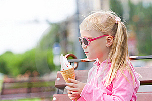 Little Blond Girl Eating Ice-cream Stock Images - Image: 15903494