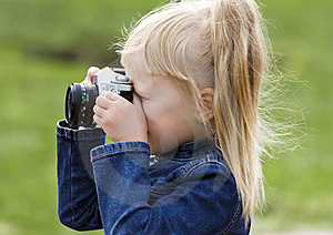 Little Girl With The Camera Royalty Free Stock Photography - Image: 15903617