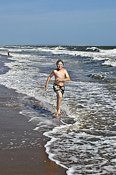 Boy Running Along The Beautiful Beach In The Waves Royalty Free Stock Photos - Image: 15906498