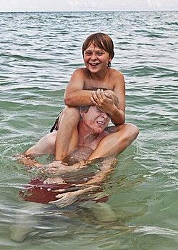 Boys Having Fun In The Beautiful Clear Sea Royalty Free Stock Photos - Image: 15907658