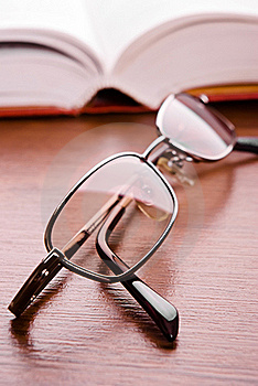 Glasses And Open Book Stock Photography - Image: 15932552