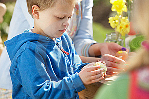Mother And Children Decorating Easter Eggs Royalty Free Stock Images - Image: 15936039