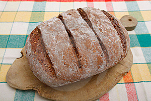 Brown Bread On Breadboard Royalty Free Stock Images - Image: 15939299