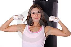 Happy Fitness Girl Flexing In Front Of Punching Ba Stock Image - Image: 15943701
