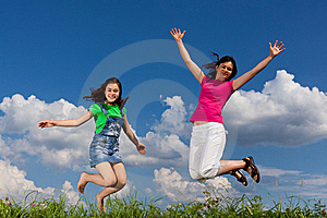 Mother And Daughter Jumping Royalty Free Stock Photos - Image: 15962988