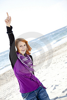 Red-haired Girl With Headphone On The Beach. Royalty Free Stock Photos - Image: 15968908