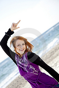 Red-haired Girl With Headphone On The Beach. Stock Images - Image: 15968914