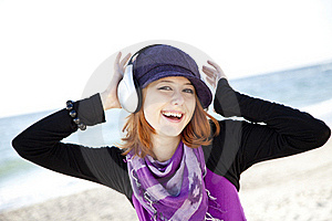 Red-haired Girl With Headphone On The Beach. Royalty Free Stock Photo - Image: 15968945