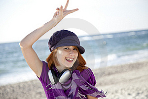 Red-haired Girl With Headphone On The Beach. Stock Photography - Image: 15969172