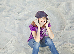 Portrait Of Red-haired Girl With Headphone Stock Photos - Image: 15969193