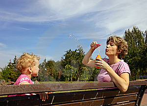 Mother And Son Blowing Soap Bubbles Stock Photography - Image: 15970242