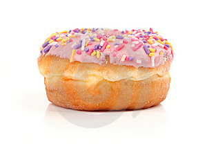 Pink Iced Donut Covered In Sprinkles Royalty Free Stock Image - Image: 15976016