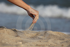 Hand Pours Sand Royalty Free Stock Photos - Image: 15978438