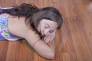 Girl Resting On The Living Room Floor Stock Photography - Image: 15981532