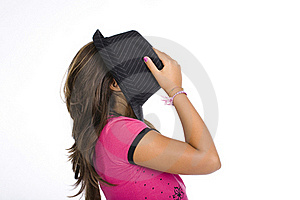 Girl Hidding Her Face With A Black Hat Stock Photo - Image: 15981590