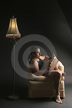 Relaxed Reading A Book Royalty Free Stock Photo - Image: 15984125