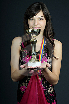 Smiling Girl Showing Cup Stock Photography - Image: 15987142