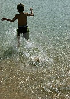 Fonctionnement dans l'eau Photos stock