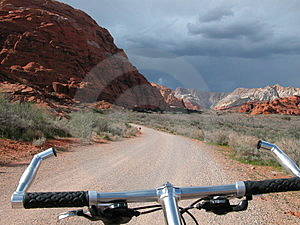 Bike Ride Into Desert Thunderstorm Stock Images