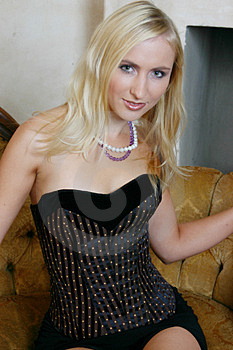 Blond Girl In Tight Corset Stock Photos