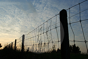 Fence at dusk Stock Photos