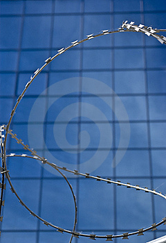 Barbed Wire On A Background Of Office Building Royalty Free Stock Images - Image: 16001799