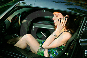 Beautiful Girl Is Talking On Telephone Royalty Free Stock Photo - Image: 16002725