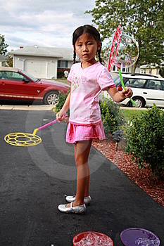 Asian Girl Playing Bubbles Royalty Free Stock Images - Image: 16011019