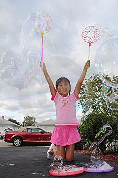 Girl Making Large Bubbles Royalty Free Stock Photo - Image: 16011025