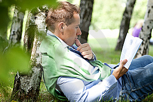 Young Man Reading Book Royalty Free Stock Image - Image: 16012756