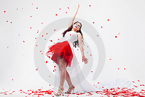 Young Beautiful Woman With Petals Of Roses Royalty Free Stock Photos - Image: 16020038