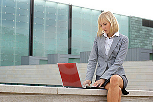 A Young Business Woman Working With A Laptop Royalty Free Stock Photography - Image: 16020047