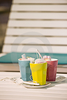 Three Cups On A  Sunbed Stock Image - Image: 16021441