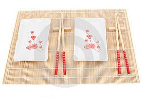 Sushi Plates And Chopsticks On Bamboo Mat Stock Images - Image: 16025954