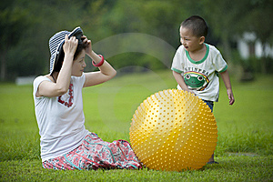 Mother And Son Play Ball In Grass Royalty Free Stock Images - Image: 16038419