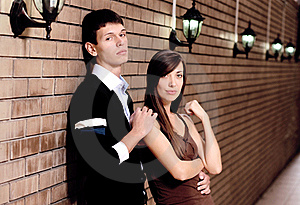 Pair Stay Near Brick Wall Stock Photo - Image: 16038590