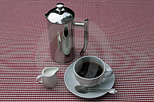 Shiny Coffee Pot And Cup Royalty Free Stock Photo - Image: 16050515