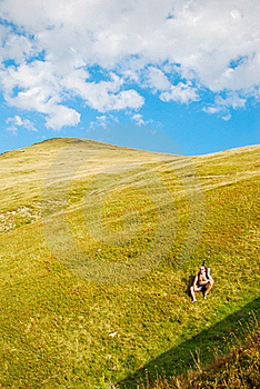 Hiker Resting On Mountain Slope Royalty Free Stock Photo - Image: 16053685