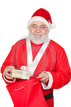 Santa Claus Getting A Gift From His Sack Royalty Free Stock Photos - Image: 16057108