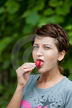 Girl Eating A Strawberry Stock Image - Image: 16061611
