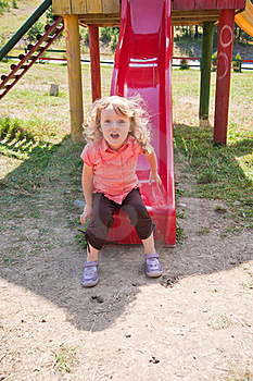 Little Girl On The Slide Royalty Free Stock Photography - Image: 16066297