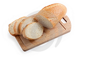A Long Loaf Sliced On A Cutting Board Stock Photography - Image: 16070282