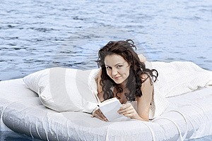 Woman Lying On The Bed In The Sea Stock Photos - Image: 16072833