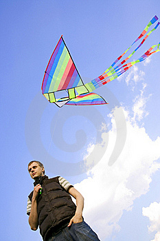 Man Playing With Multicolored Kite Stock Photography - Image: 16084042