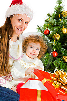 Opening Christmas Present Royalty Free Stock Images - Image: 16084589