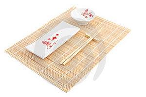 Sushi Plates And Chopsticks On Bamboo Mat Stock Image - Image: 16088261